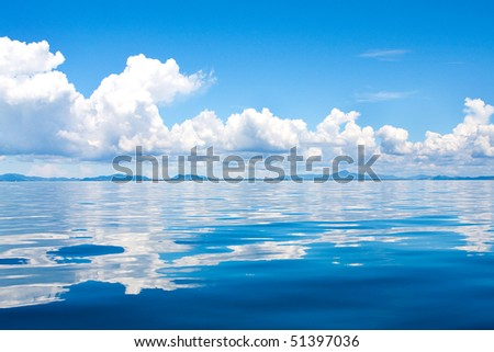 Beautiful cumulus clouds in the horizon above tropical islands in the sea - stock photo