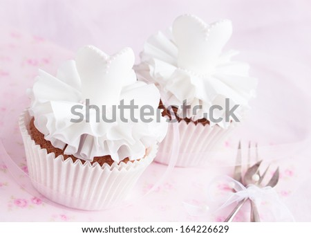 Beautiful cupcakes for wedding or little ballerina. Decorated with sugarpaste dress. Selective focus - stock photo