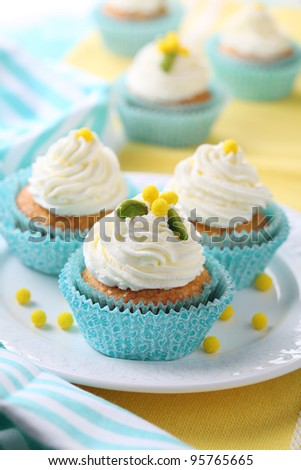 Beautiful cupcakes with cream and sugar decoration.