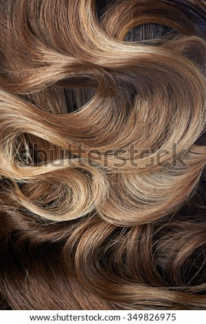 Beautiful curl hairstyle of brown hair ,close up