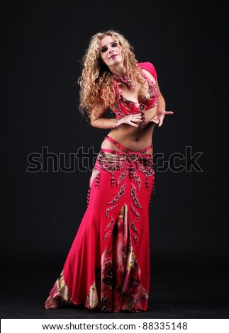 beautiful curly blonde in the active Arab Dance