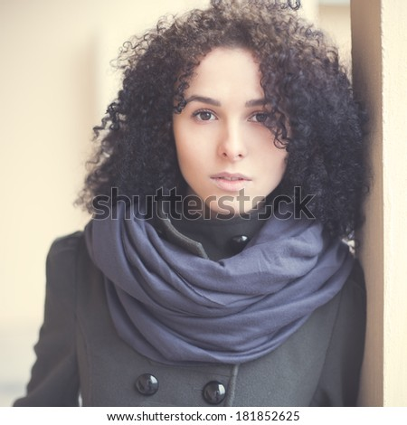 Beautiful curly girl in the French style