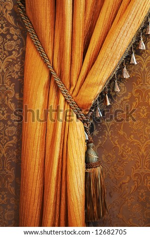 Beautiful curtain with a cord in a fashionable apartment - stock photo