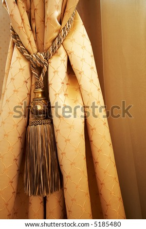 Beautiful curtain with a cord in a fashionable apartment