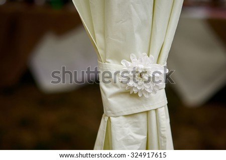 Beautiful curtain with a flower. - stock photo