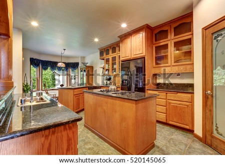 Kitchen luxury home stock photo 165286667 shutterstock for Beautiful custom kitchen cabinets