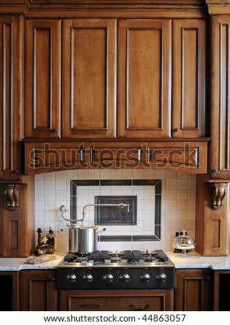 Beautiful custom gourmet kitchen - stock photo