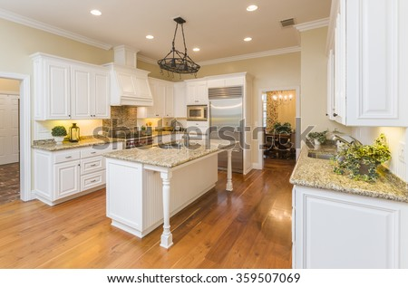 Beautiful Custom Kitchen Interior in a New House. - stock photo