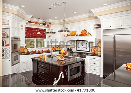 Beautiful Custom Kitchen Interior With Fall Decorations in a New House - stock photo
