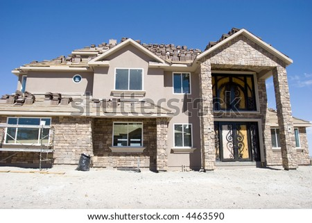 Beautiful custom made luxury home under construction - stock photo