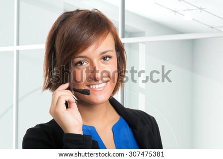 Beautiful customer representative portrait - stock photo