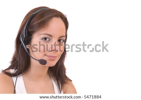 Beautiful customer representative with headset smiling during a telephone conversation - over a white background
