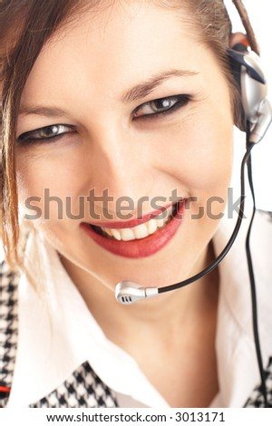 Beautiful Customer Representative with headset smiling during a telephone conversation - small DOF - focus mainly on the eyes and nose