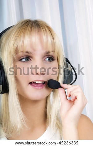 Beautiful customer service operator woman with headset. Over white