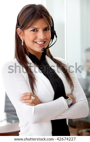 Beautiful customer support operator woman looking happy - stock photo