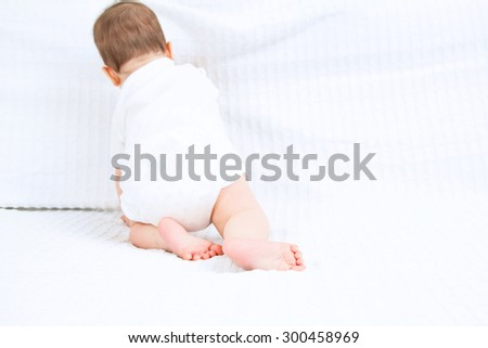 Beautiful cute baby backside on white background