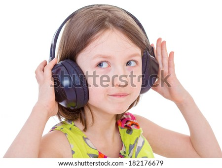 Beautiful cute happy little girl with headphones on white