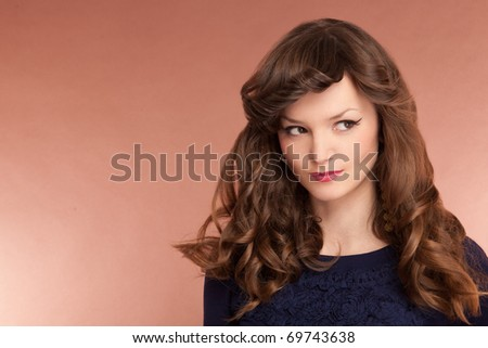 Beautiful cute lady with long curly hair - stock photo