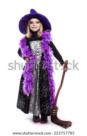 Beautiful cute little girl in witch halloween costume hold the broom. Studio portrait isolated over white - stock photo