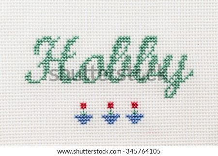 Beautiful cute miniature embroidery word Hobby with indoor pot flowers. Handmade crafts inscription for the site - stock photo