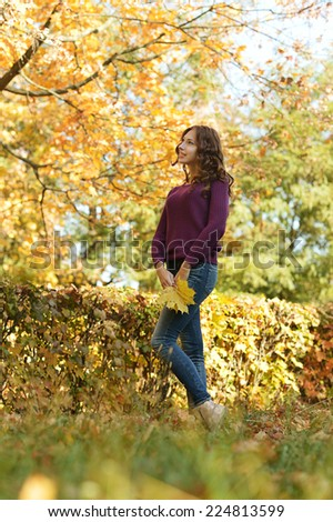 beautiful cute young woman in autumn park