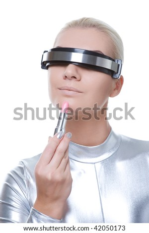 Beautiful cyber woman applying make-up