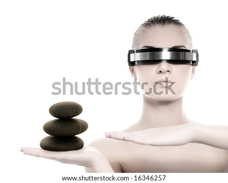 Beautiful cyber woman balancing with a stone tower isolated on white background - stock photo