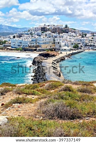 beautiful Cyclades Island Naxos seen from the famous landmark the Portara with the natural stone walkway towards the village