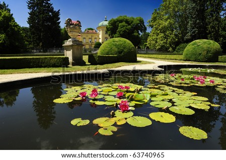 Beautiful Czech baroque castle Buchlovice and a beautiful park surrounding it - stock photo