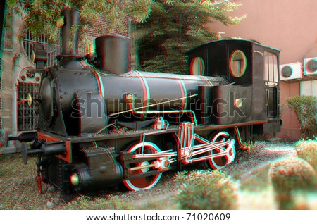 Beautiful 3D anaglyph stereo image of an old-time locomotive. Great travel and transportation concept for diverse advertising materials. To view this image you need stereo glasses. - stock photo