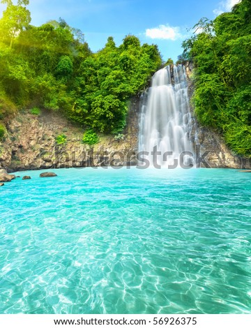"Beautiful ""Dambri"" waterfall in tropical forest. Vietnam - stock photo"