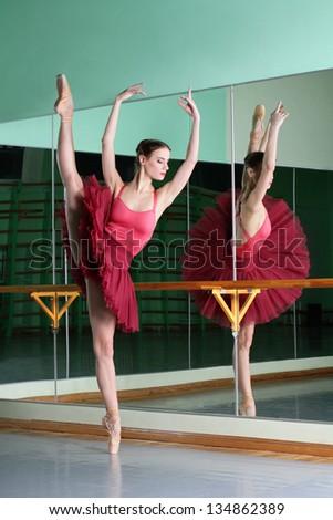 beautiful dancer ballerina is doing exercises in ballet class - stock photo
