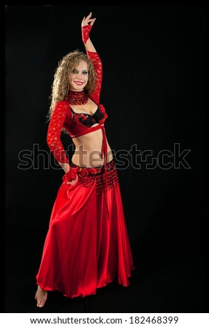 Beautiful  dancer in eastern costume on black background
