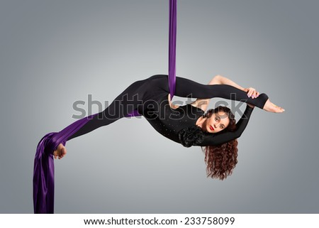 Beautiful dancer on aerial silk, aerial contortion, aerial ribbons, aerial silks, aerial tissues, fabric, ribbon, tissue - stock photo