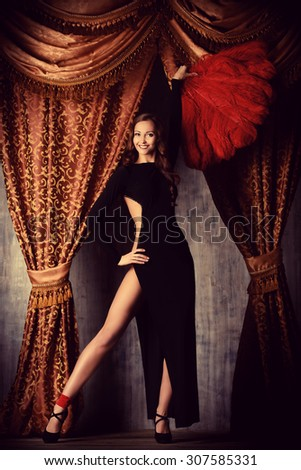 Beautiful dancer on the stage of cabaret. Performance. Beauty, fashion. - stock photo