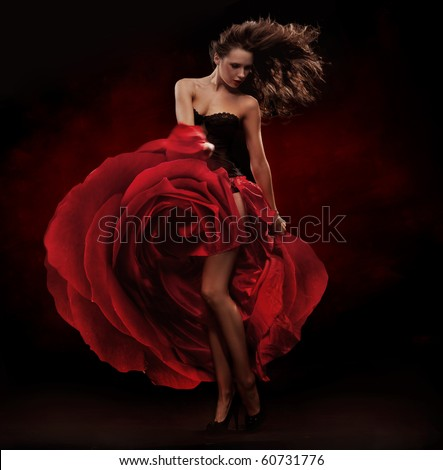 Beautiful dancer wearing red dress - stock photo