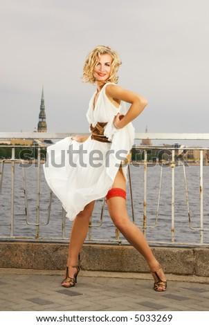 Beautiful dancing blond girl - stock photo
