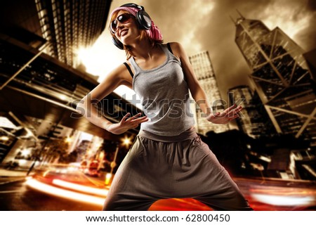 Beautiful dancing girl on a street - stock photo