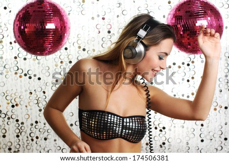 beautiful dancing woman with headphones - stock photo