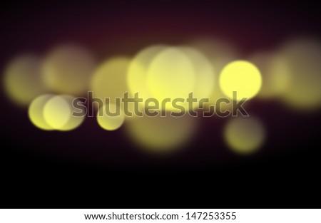 Beautiful dark background with blurred golden lights - stock photo
