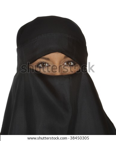 Beautiful dark eyed woman in traditional middle eastern niqab veil - stock photo