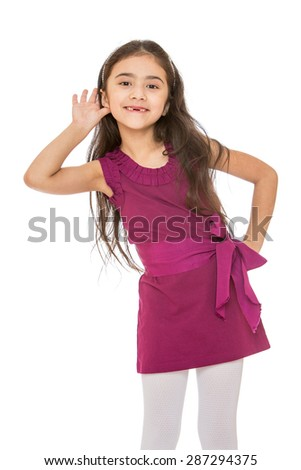 Beautiful dark-haired girl in a short velvet dress had a hand to his ear-Isolated on white background - stock photo