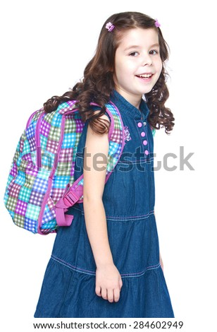 Beautiful dark-haired girl school girl with a school knapsack behind- isolated on white background - stock photo