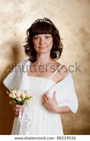 Beautiful dark haired woman in white bridal dress