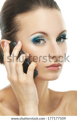 Beautiful dark-haired woman talking on cell phone, close-up, isolated on white background. - stock photo