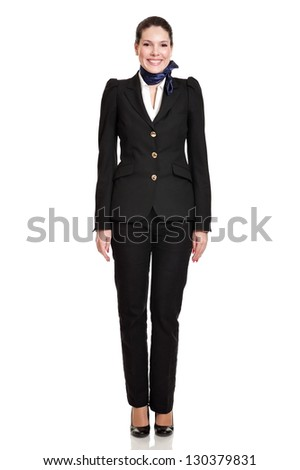 Beautiful dark haired young business woman dressed in a black suit with a blue scarf, smiling, standing, natural makeup,isolated on white background - stock photo