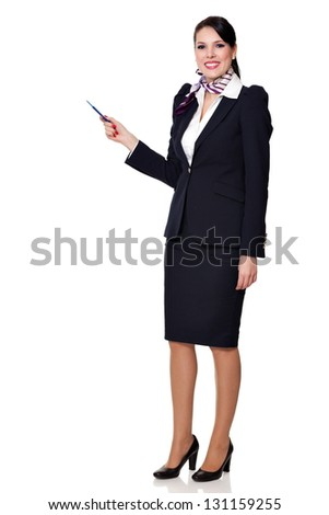 Beautiful dark haired young business woman dressed in a navy suit with a purple scarf and white shirt standing smiling and showing to upper left with her pen, isolated on white background - stock photo