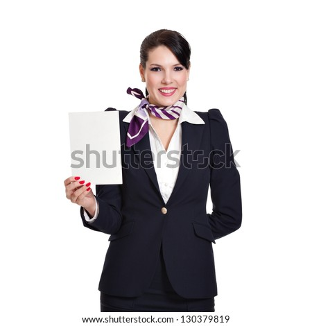 Beautiful dark haired young business woman dressed in a navy suit with a purple scarf holding a blank sheet of cardboard in her right hand, isolated on white background - stock photo
