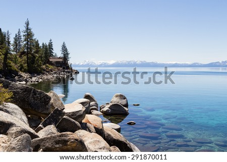 beautiful day at Lake Tahoe, clear blue water reflecting the blue sky