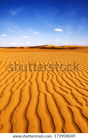 Beautiful day in Sahara. Pattern in the desert, Sahara - Tunis. Visible large-scale structure of the sand! Vibrant Color.